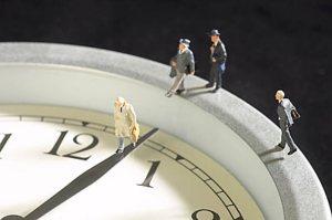 models-of-businessmen-walking-along-clock-uid-1171179